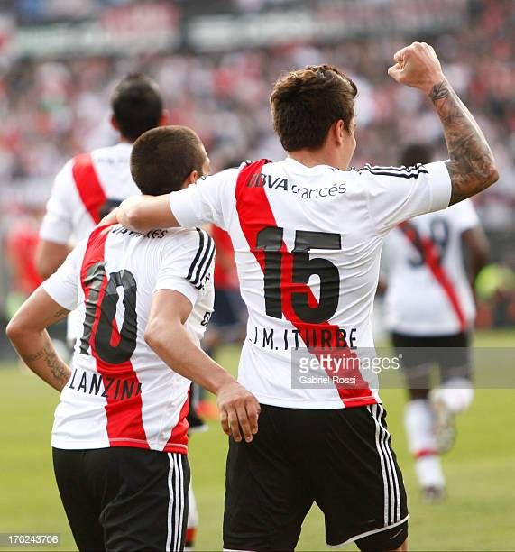 Manuel Lanzini and Juan Iturbe of River Plate celebrate a goal during a match between River Plate and Independiente as part of the Torneo Final 2013...