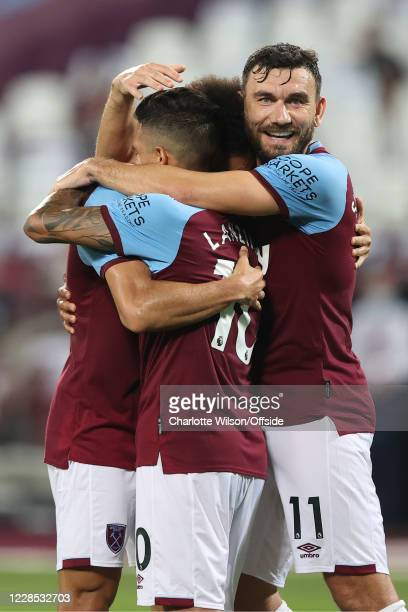 Manuel Lanzini and Robert Snodgrass of West Ham celebrate their 3rd goal with goalscorer Felipe Anderson during the match between West Ham United and...
