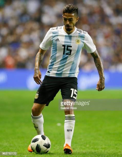 Manuel Lanzini of Argentina drives the ball during an international friendly match between Argentina and Haiti at Alberto J Armando Stadium on May 29...