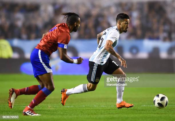 Manuel Lanzini of Argentina runs after the ball while followed by Carlens Arcus of Haiti during an international friendly match between Argentina and...
