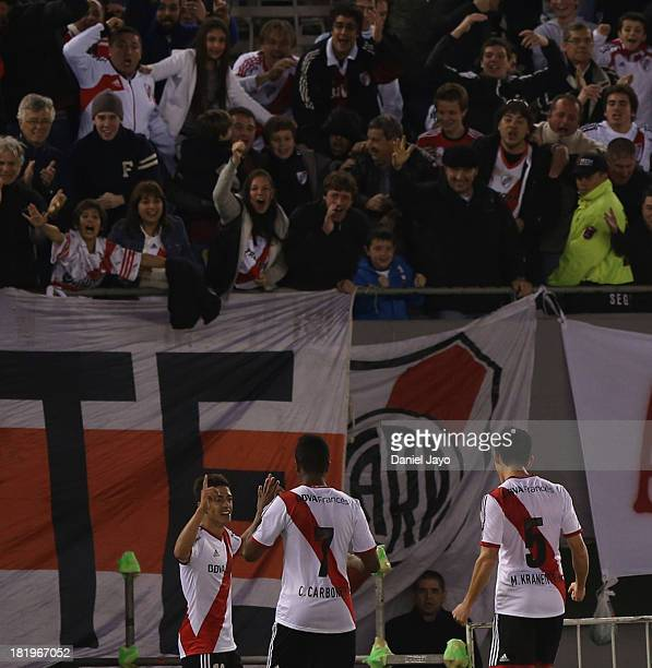 Manuel Lanzini of River Plate celebrates with teammates after scoring during a match between River Plate and Liga de Loja as part of the Copa Total...