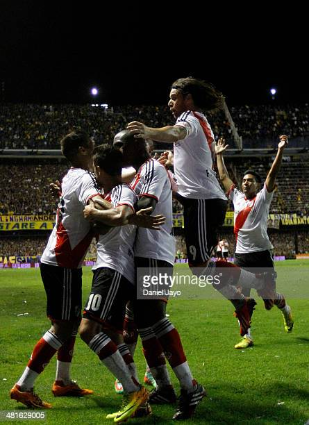 Manuel Lanzini of River Plate celebrates with teammates after scoring the first goal during a match between Boca Juniors and River Plate as part of...
