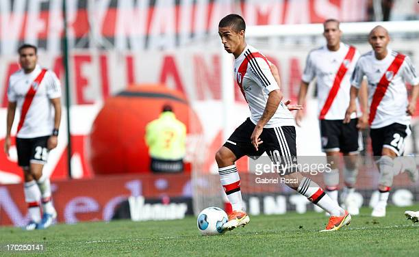 Manuel Lanzini of River Plate drives the ball during a match between River Plate and Independiente as part of the Torneo Final 2013 at the Monumental...