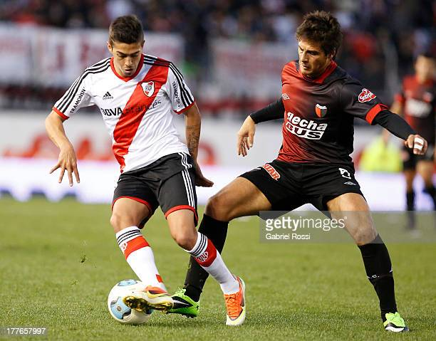 Manuel Lanzini of River Plate fights for the ball with Sebastian Prediger of Colon during a match between River Plate and Colon de Santa Fe as part...