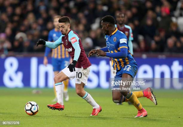 Manuel Lanzini of West Ham United and Aristote Nsiala of Shrewsbury Town during the Emirates FA Cup Third Round Repaly match between West Ham United...
