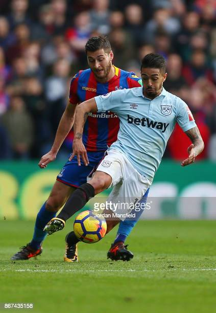 Manuel Lanzini of West Ham United and Joel Ward of Crystal Palace in action during the Premier League match between Crystal Palace and West Ham...