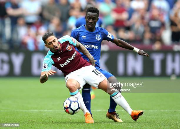 Manuel Lanzini of West Ham United battles for possession with Idrissa Gueye of Everton during the Premier League match between West Ham United and...