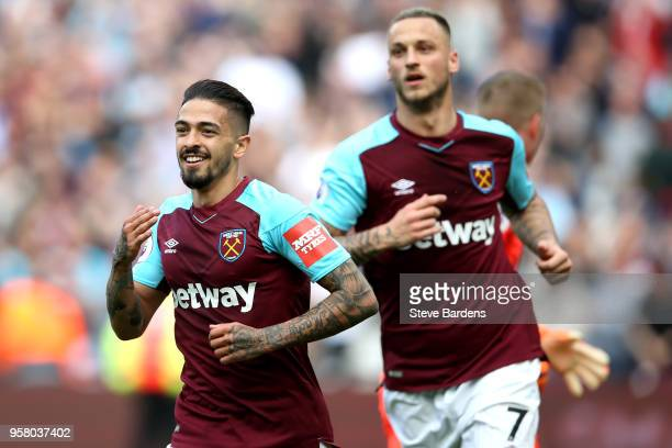 Manuel Lanzini of West Ham United celebrates after scoring his sides first goal and Marko Arnautovic of West Ham United looks on during the Premier...