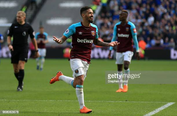 Manuel Lanzini of West Ham United celebrates scoring his sides third goal during the Premier League match between West Ham United and Everton at...