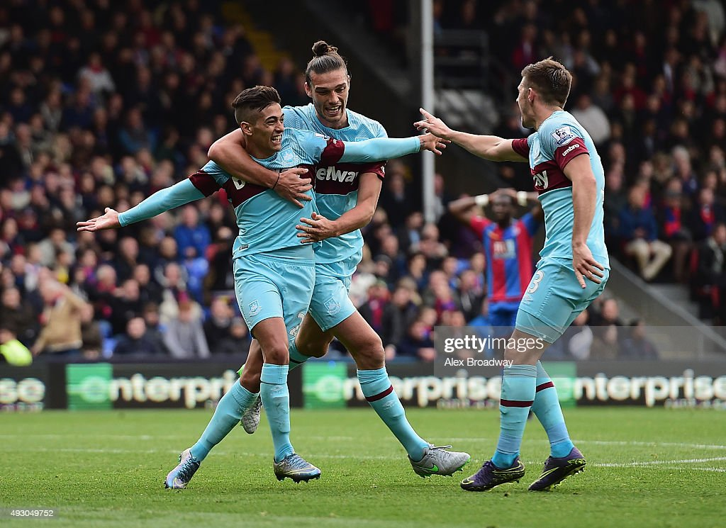 Manuel Lanzini (L) of West Ham United celebrates scoring his team's second goal with his team mates Andy Carroll (C) and Aaron Cresswell (R) during the Barclays Premier League match between Crystal Palace and West Ham United at Selhurst Park on October 17, 2015 in London, England.