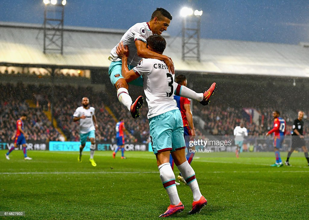 Manuel Lanzini of West Ham United celebrates scoring the opening goal with Aaron Cresswell during the Premier League match between Crystal Palace and West Ham United at Selhurst Park on October 15, 2016 in London, England.