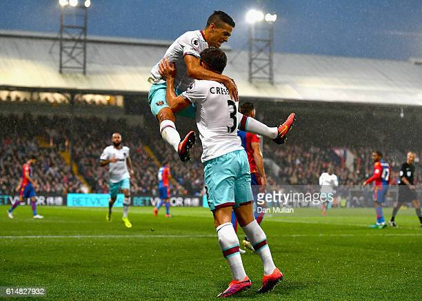 Manuel Lanzini of West Ham United celebrates scoring the opening goal with Aaron Cresswell during the Premier League match between Crystal Palace and...