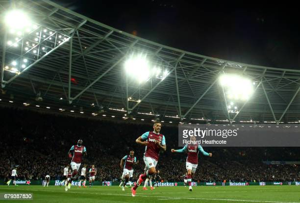 Manuel Lanzini of West Ham United celebrates scoring the opening goal during the Premier League match between West Ham United and Tottenham Hotspur...