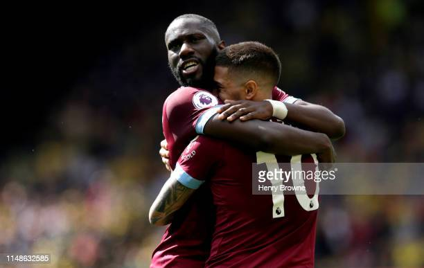 Manuel Lanzini of West Ham United celebrates with teammate Arthur Masuaku after scoring his team's second goal during the Premier League match...