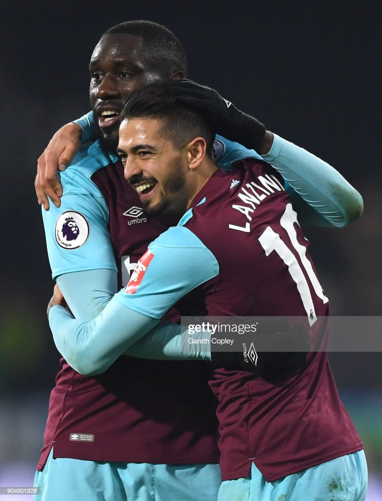 Manuel Lanzini of West Ham United celebrates with teammate Cheikhou Kouyate after scoring his sides fourth goal during the Premier League match between Huddersfield Town and West Ham United at John Smith's Stadium on January 13, 2018 in Huddersfield, England.