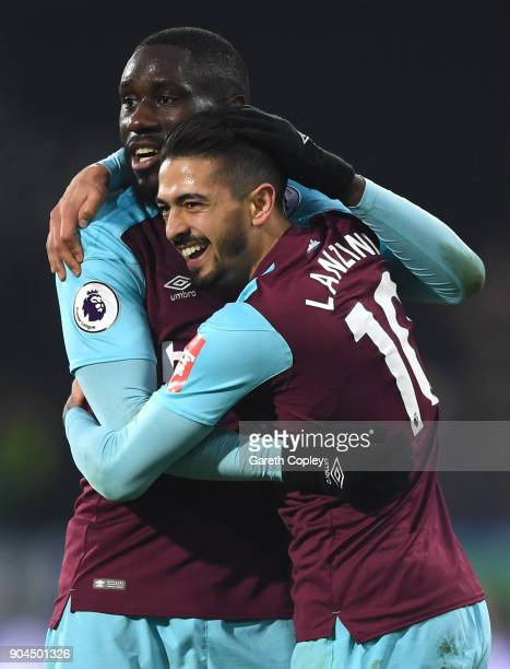 Manuel Lanzini of West Ham United celebrates with teammate Cheikhou Kouyate after scoring his sides fourth goal during the Premier League match...