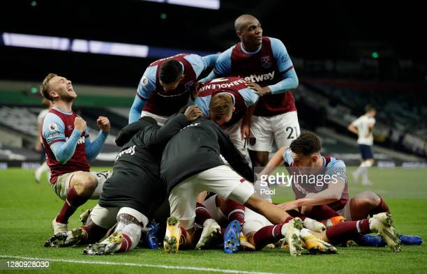 Manuel Lanzini of West Ham United celebrates with teammates after scoring his team's third goal during the Premier League match between Tottenham...