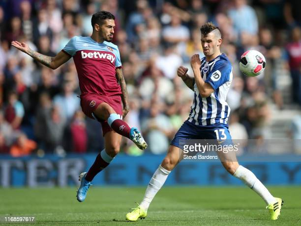 Manuel Lanzini of West Ham United clears the ball from Pascal Gross of Brighton and Hove Albion during the Premier League match between Brighton Hove...