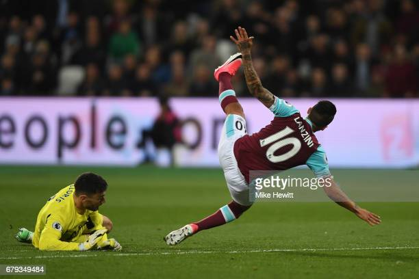 Manuel Lanzini of West Ham United collides with Hugo Lloris of Tottenham Hotspur during the Premier League match between West Ham United and...