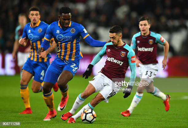 Manuel Lanzini of West Ham United evades Aristote Nsiala of Shrewsbury Town during The Emirates FA Cup Third Round Replay match between West Ham...