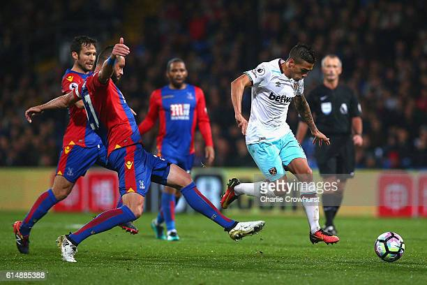 Manuel Lanzini of West Ham United evades Damien Delaney of Crystal Palace during the Premier League match between Crystal Palace and West Ham United...