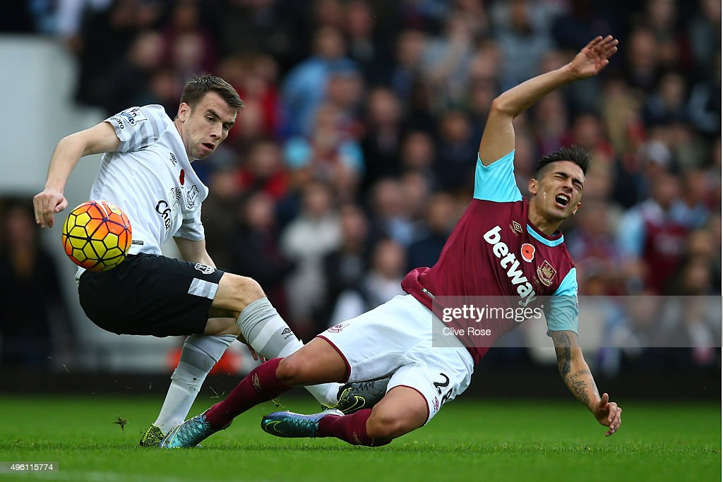 Manuel Lanzini of West Ham United is brought down by Seamus Coleman of Everton during the Barclays Premier League match between West Ham United and Everton at Boleyn Ground on November 7, 2015 in London, England.