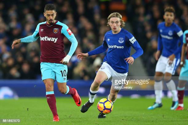 Manuel Lanzini of West Ham United is challenged by Tom Davies of Everton during the Premier League match between Everton and West Ham United at...