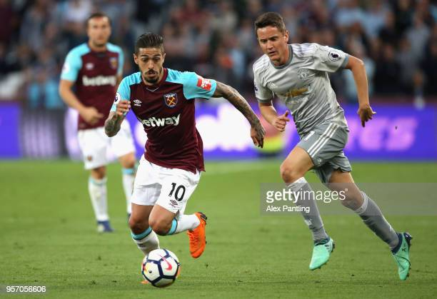Manuel Lanzini of West Ham United is chased down by Ander Herrera of Manchester United during the Premier League match between West Ham United and...