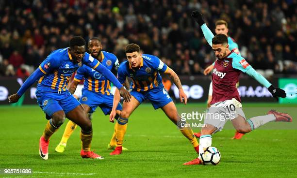 Manuel Lanzini of West Ham United is faced by the Shrewsbury Town defence as he misses a chance during The Emirates FA Cup Third Round Replay match...