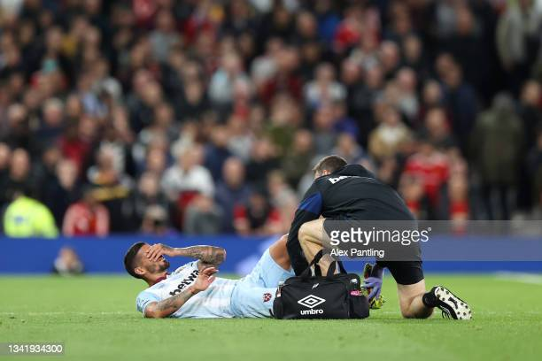 Manuel Lanzini of West Ham United receives medical treatment during the Carabao Cup Third Round match between Manchester United and West Ham United...