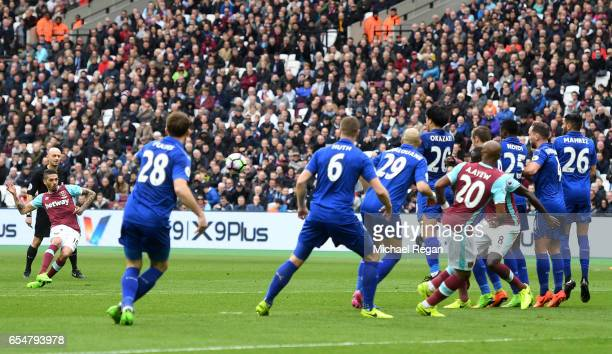 Manuel Lanzini of West Ham United scores his sides first goal during the Premier League match between West Ham United and Leicester City at London...