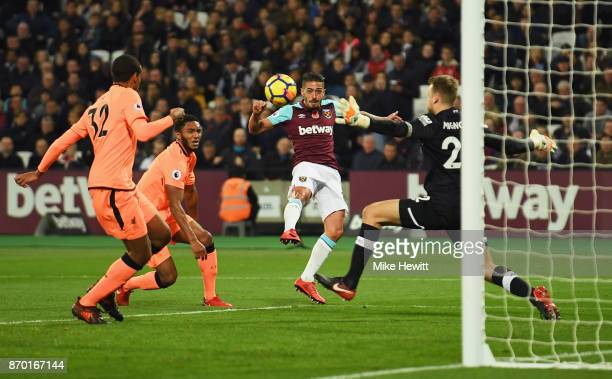 Manuel Lanzini of West Ham United scores his sides first goal during the Premier League match between West Ham United and Liverpool at London Stadium...