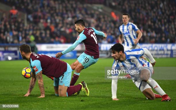 Manuel Lanzini of West Ham United scores his sides fourth goal during the Premier League match between Huddersfield Town and West Ham United at John...