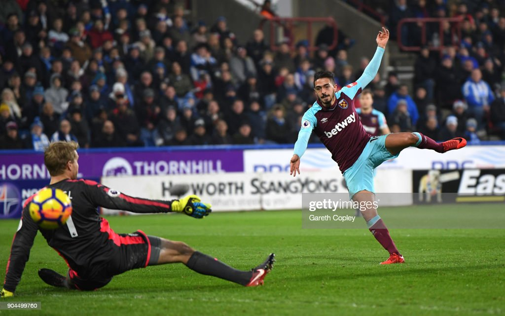 Manuel Lanzini of West Ham United scores his sides third goal during the Premier League match between Huddersfield Town and West Ham United at John Smith's Stadium on January 13, 2018 in Huddersfield, England.