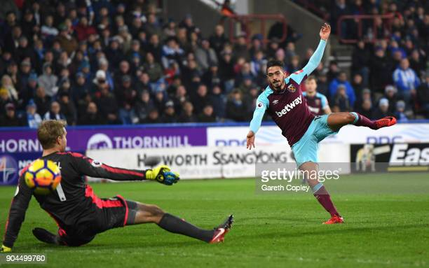 Manuel Lanzini of West Ham United scores his sides third goal during the Premier League match between Huddersfield Town and West Ham United at John...