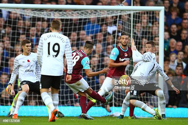 Manuel Lanzini of West Ham United scores his team's first goal during the Barclays Premier League match between West Ham United and Everton at Boleyn...