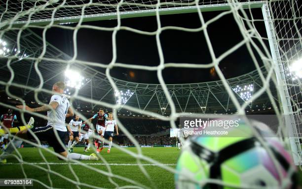 Manuel Lanzini of West Ham United scores the opening goal during the Premier League match between West Ham United and Tottenham Hotspur at the London...