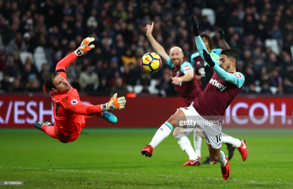 Manuel Lanzini of West Ham United shoots as Asmir Begovic of AFC Bournemouth saves during the Premier League match between West Ham United and AFC Bournemouth at London Stadium on January 20, 2018 in London, England.