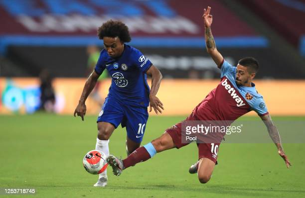Manuel Lanzini of West Ham United tackles Willian of Chelsea during the Premier League match between West Ham United and Chelsea FC at London Stadium...