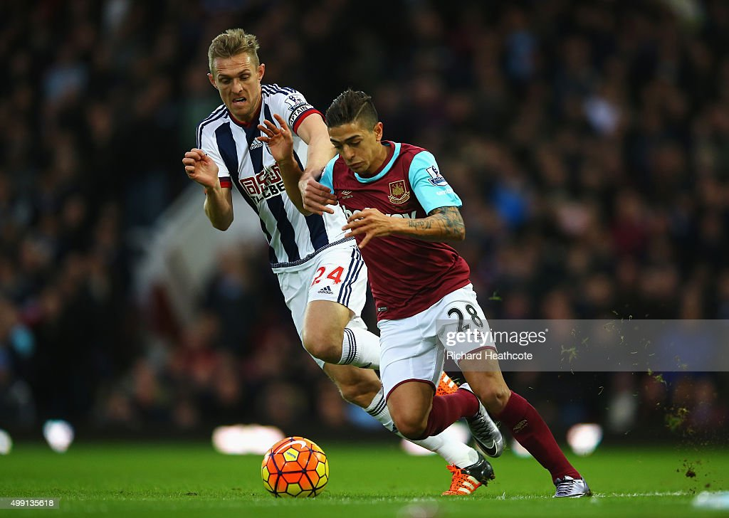Manuel Lanzini of West Ham United takes on Darren Fletcher of West Bromwich Albion during the Barclays Premier League match between West Ham United and West Bromwich Albion at Boleyn Ground on November 29, 2015 in London, England.