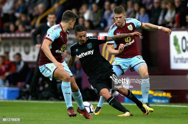 Manuel Lanzini of West Ham United takes on the Burnley defence during the Premier League match between Burnley and West Ham United at Turf Moor on...