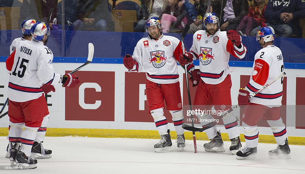 Manuel Latusa #15 of Red Bull Salzburg and team mates Ben Walter #11, Matthias Trattnig #51 and Brian Fahey #2 celebrate after Salzburg scored to tie the game during the Champions Hockey League group stage game between HV71 Jonkoping and Red Bull Salzburg on August 24, 2014 in Jonkoping, Sweden.
