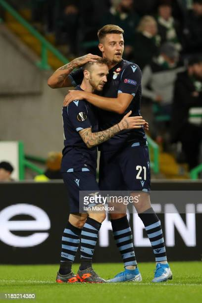 Manuel Lazzari of Lazio celebrates with Sergej MilinkovicSavic after he scores his team's first goal during the UEFA Europa League group E match...
