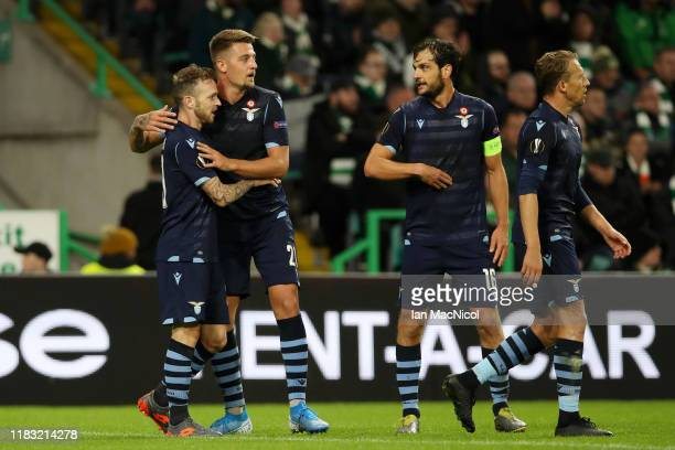 Manuel Lazzari of Lazio celebrates with team mates after he scores his team's first goal during the UEFA Europa League group E match between Celtic...