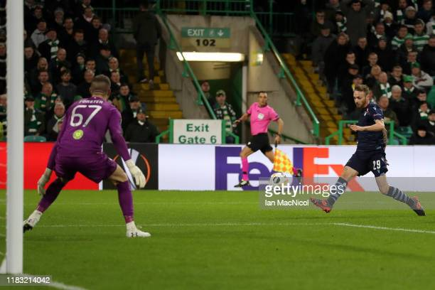 Manuel Lazzari of Lazio scores his team's first goal during the UEFA Europa League group E match between Celtic FC and Lazio Roma at Celtic Park on...