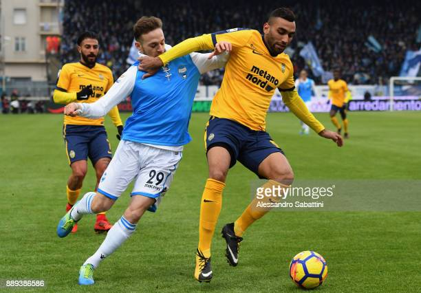Manuel Lazzari of Spal competes for the ball with Mohamed Selim Fares of Hellas Verona during the Serie A match between Spal and Hellas Verona FC at...
