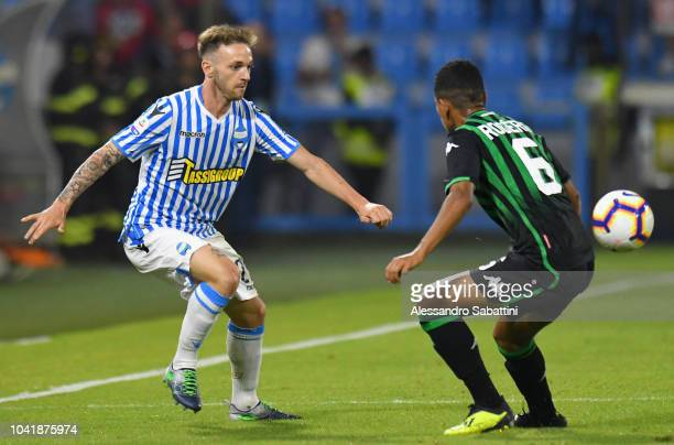 Manuel Lazzari of Spal competes for the ball with Rogerio of Sassuolo during the serie A match between SPAL and US Sassuolo at Stadio Paolo Mazza on...
