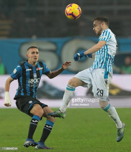 Manuel Lazzari of Spal jumps for the ball against Timothy Castagne of Atalanta BC during the Serie A match between Atalanta BC and SPAL at Stadio...