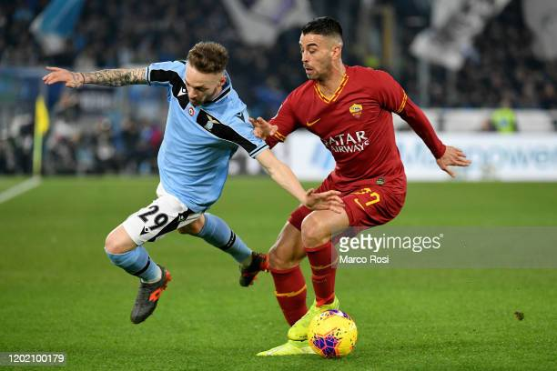 Manuel Lazzari of SS Lazio compete for the bal with Leonardi Spinazzola of AS Roma during the Serie A match between AS Roma and SS Lazio at Stadio...