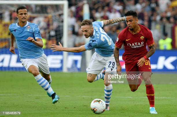 Manuel Lazzari of SS Lazio compete for the ball with Patrik Kluvert of AS Roma during the Serie A match between SS Lazio and AS Roma at Stadio...